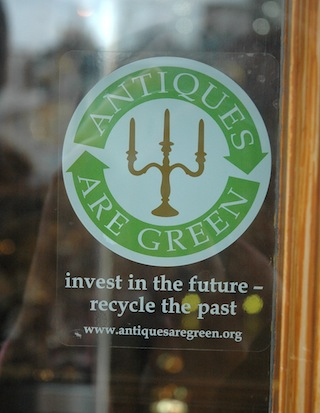 """Antiques are green"" - seen on a shop window on Portobello Road"