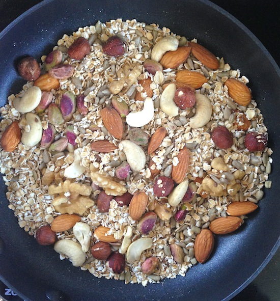 Nuts and oats roasting in the pan