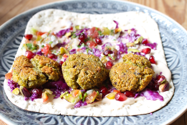 Pistachio falafel with pomegranate salsa and cashew yogurt sauce